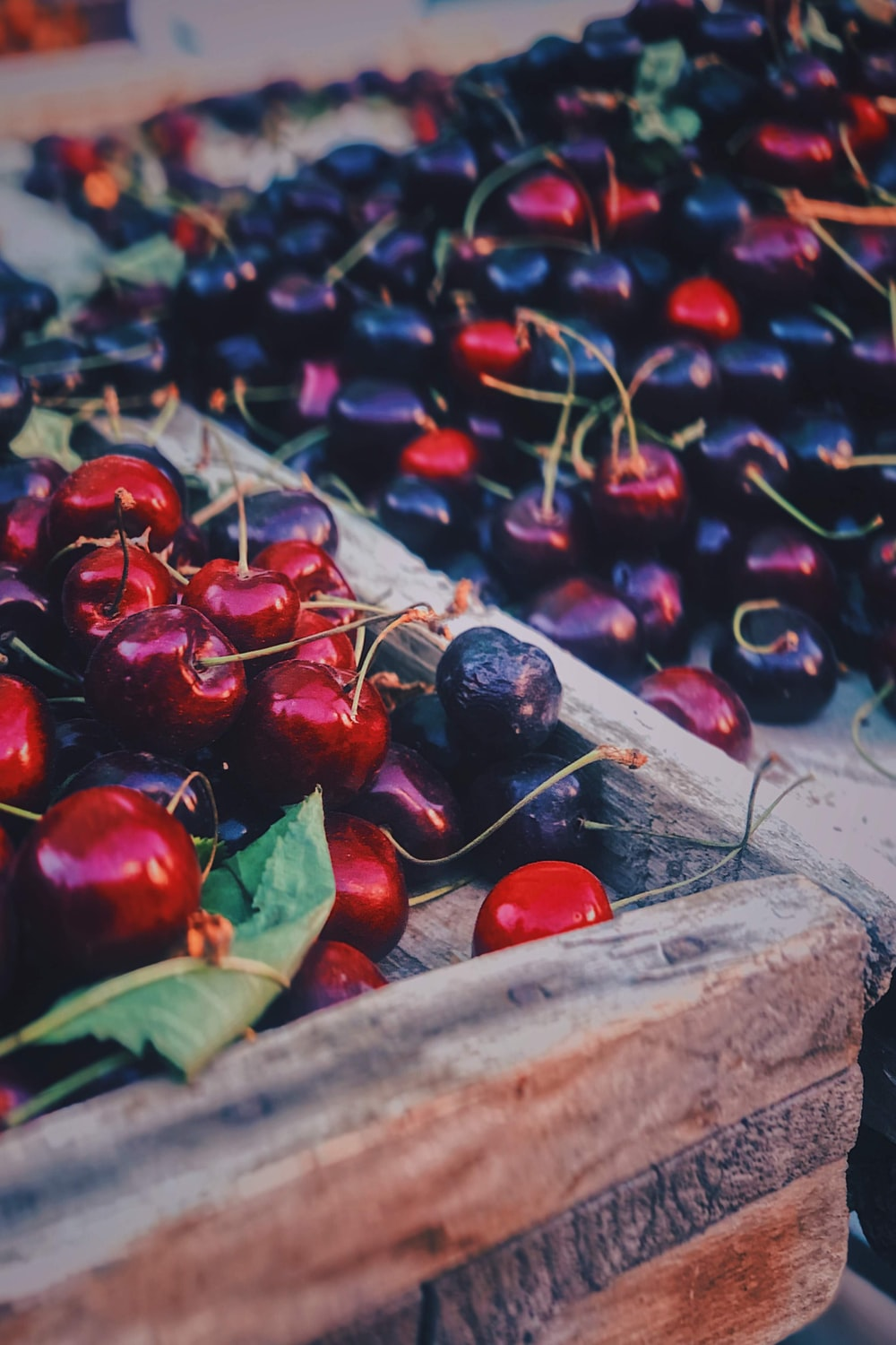 red cherries on brown wooden table