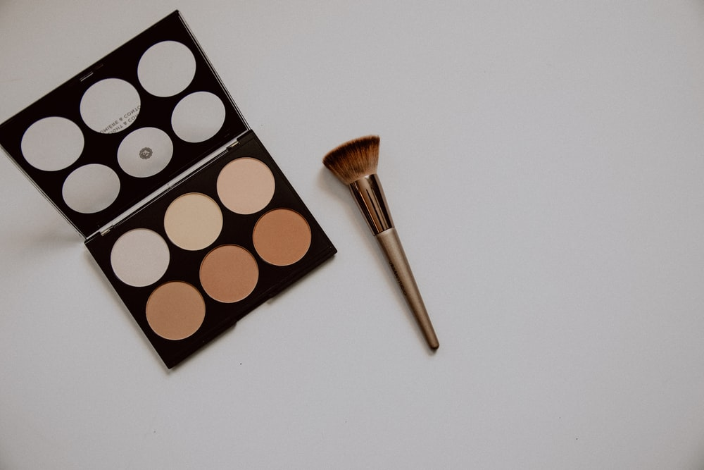 brown and white makeup brush