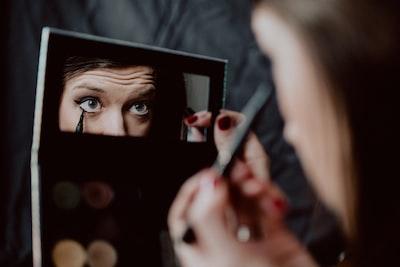 Woman applying liquid black eyeliner