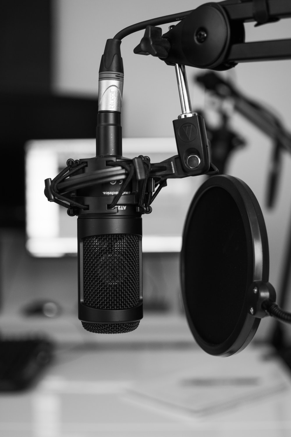 black and silver microphone on black and white photography
