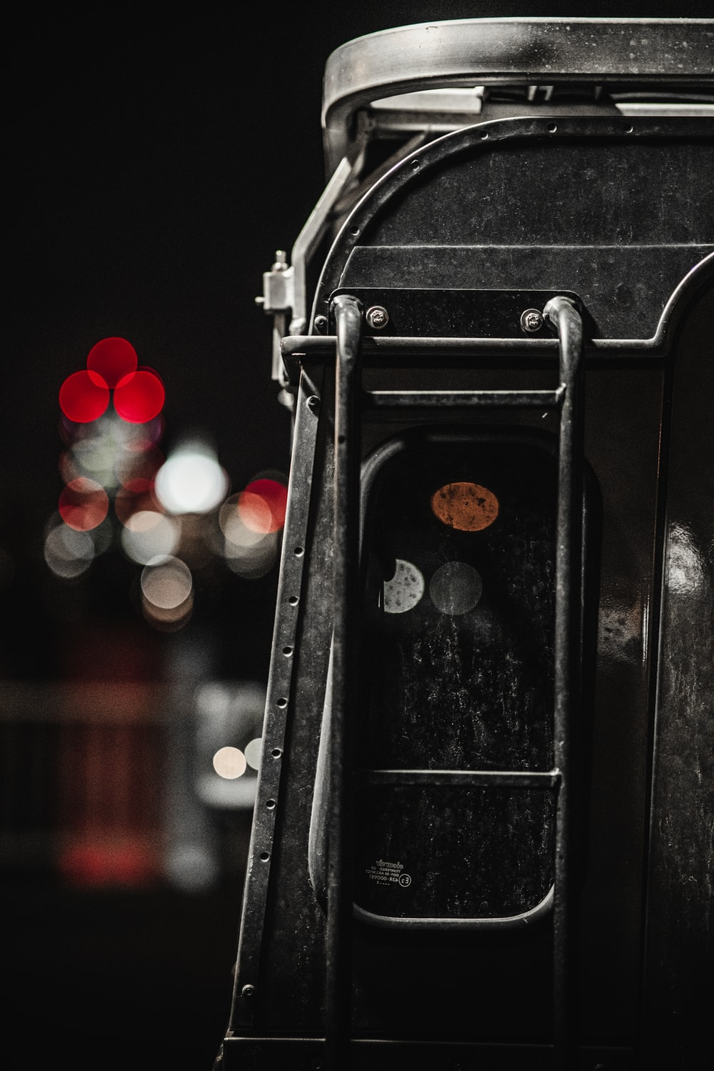 black train rail with red and white bokeh lights