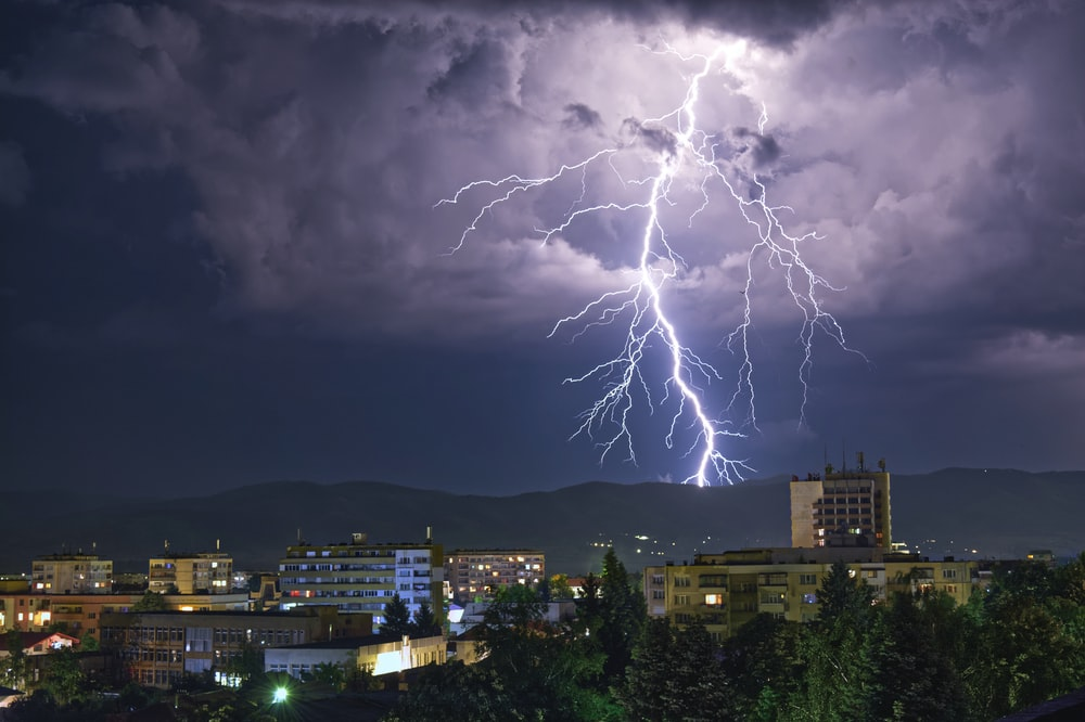 lightning UNK on city during night time