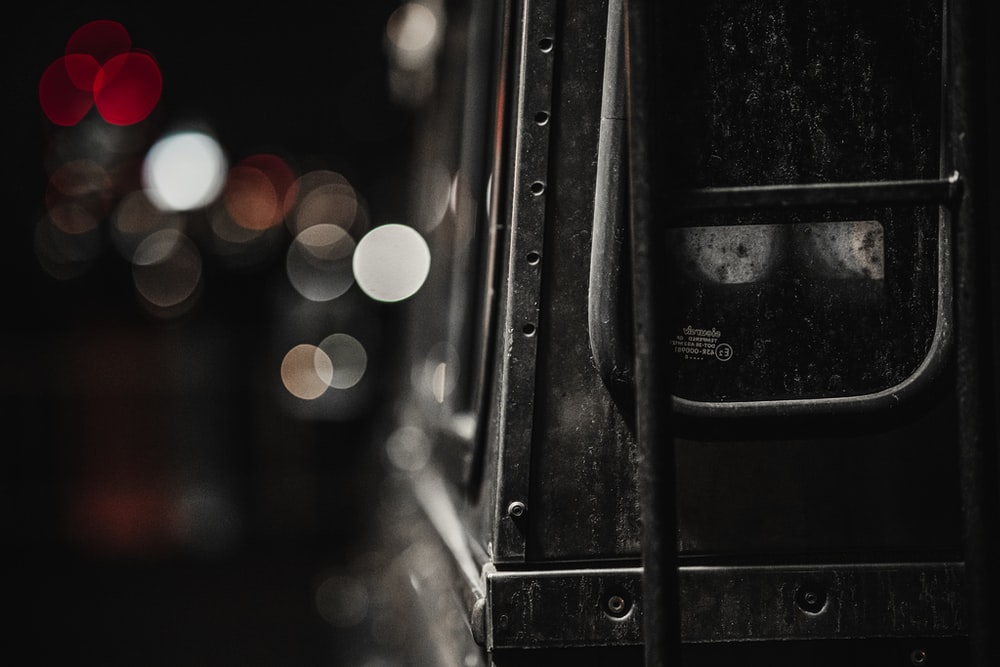 bokeh photography of black steel frame