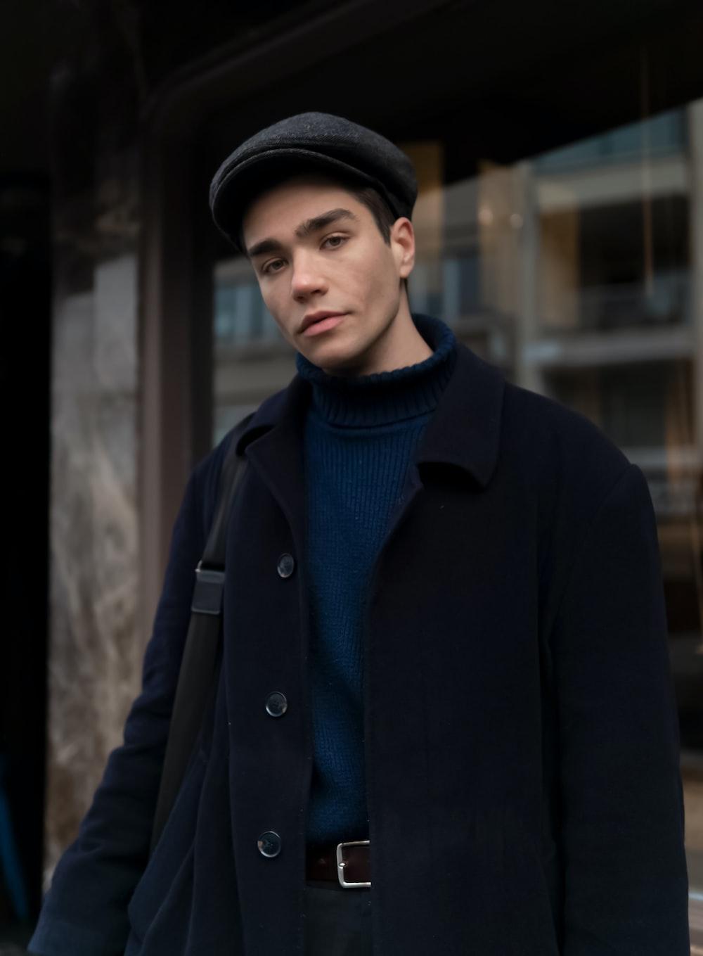man in black coat and black hat