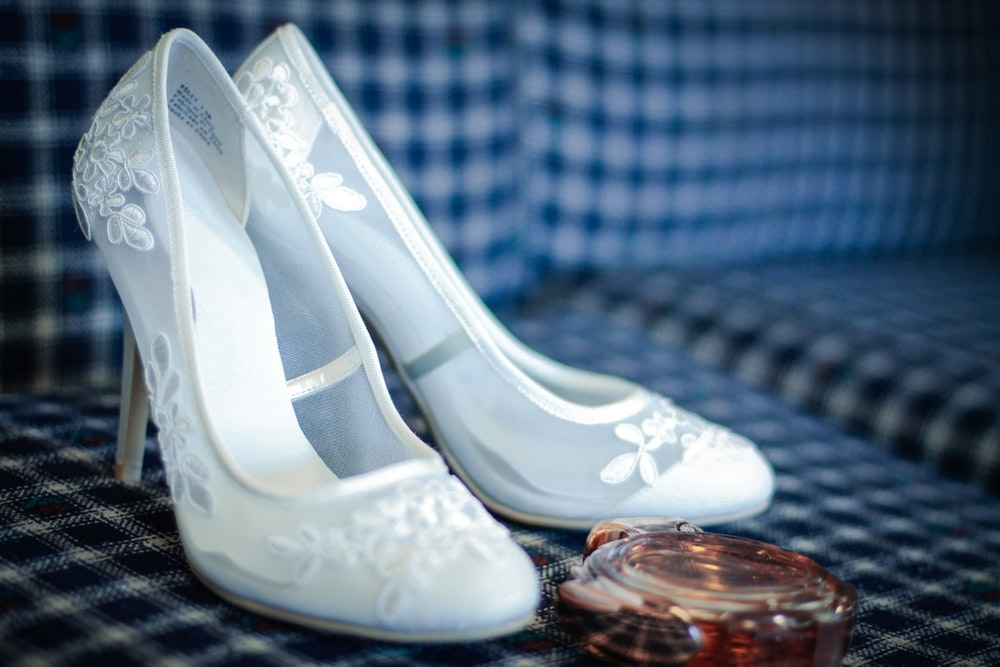 white leather peep toe pumps