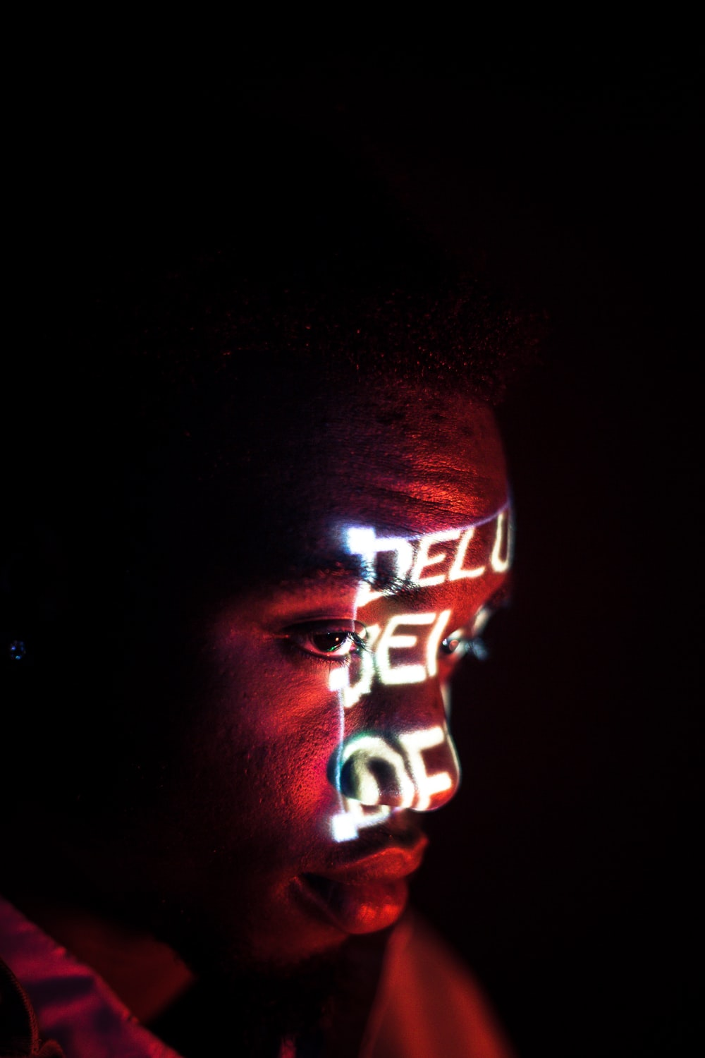 man with red and white light on face