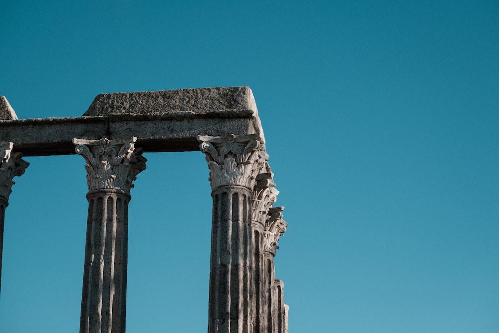 gray concrete pillar under blue sky during daytime