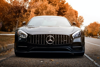 black mercedes benz car on road during daytime automobile zoom background