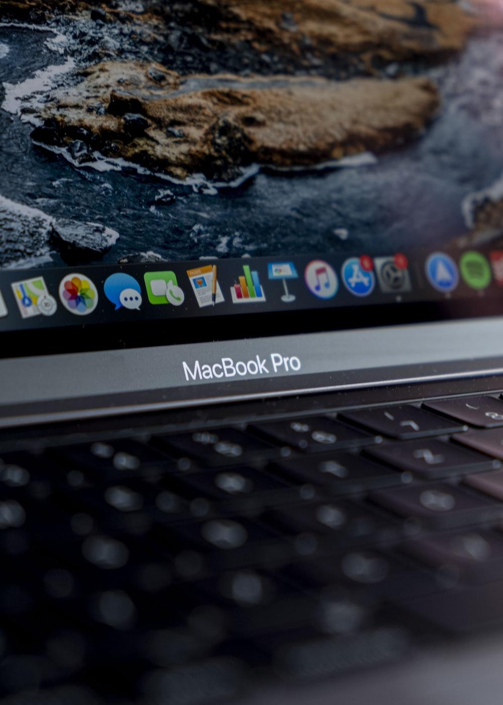 macbook pro displaying white and black rocks