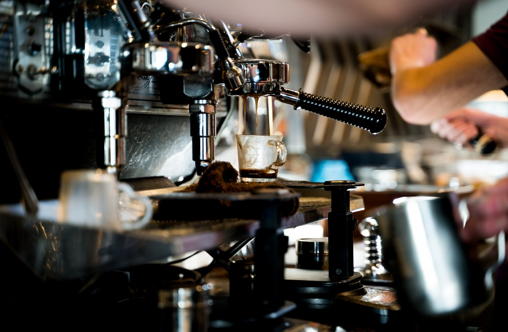 stainless steel espresso machine on black table