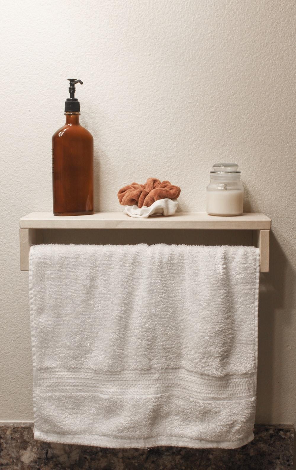 brown bottle on white towel