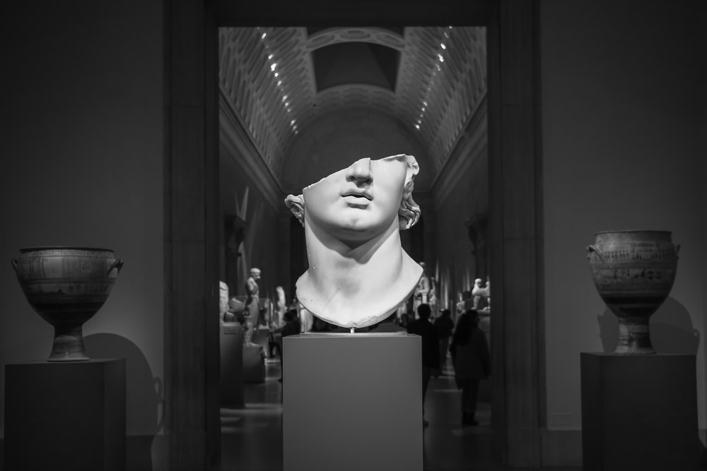 grayscale photo of woman statue