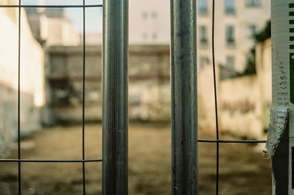 black metal fence during daytime