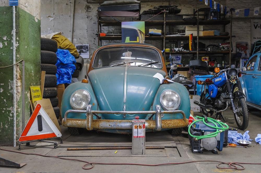 blue volkswagen beetle parked on parking lot
