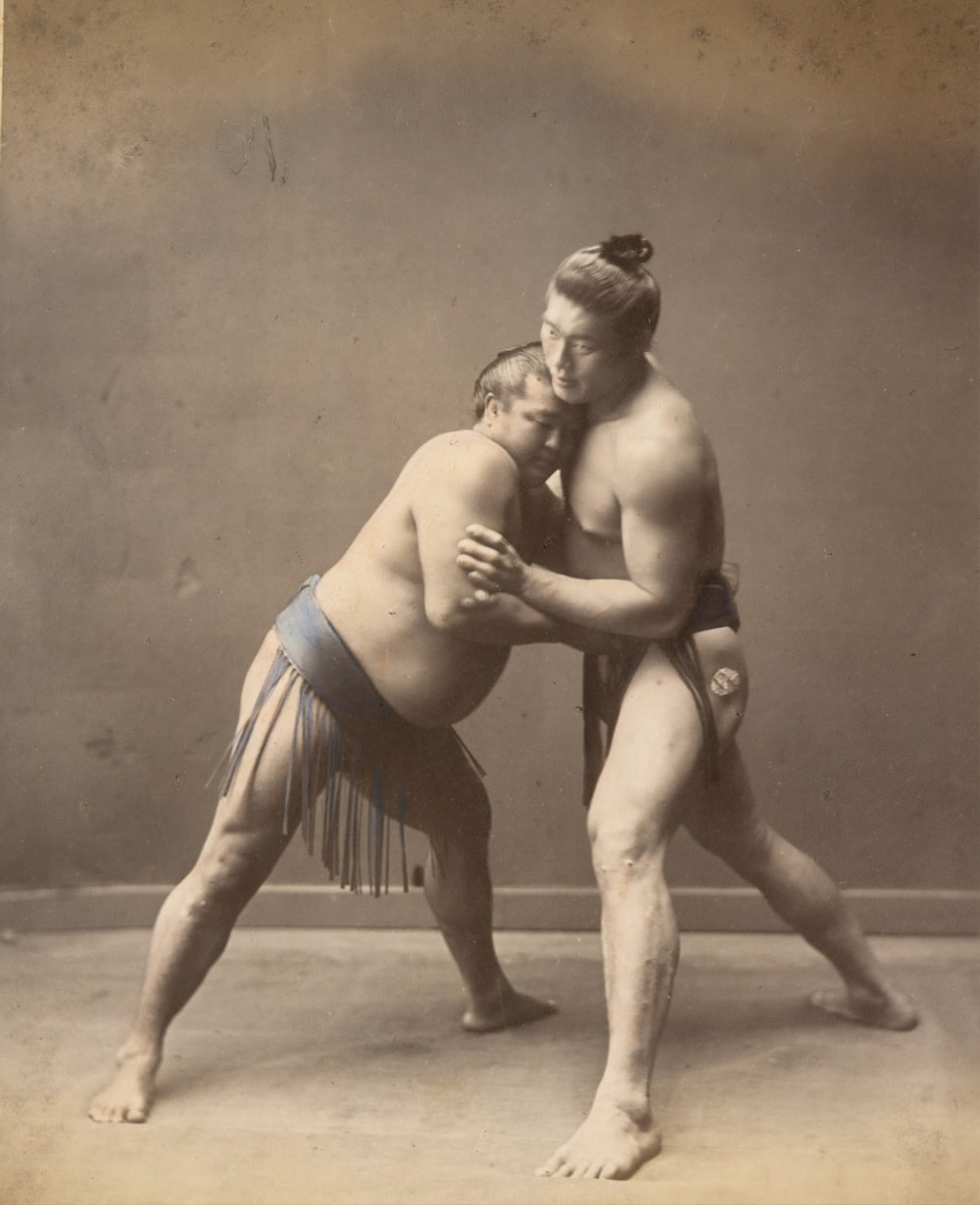 Historical image of sumo wrestlers in 1870