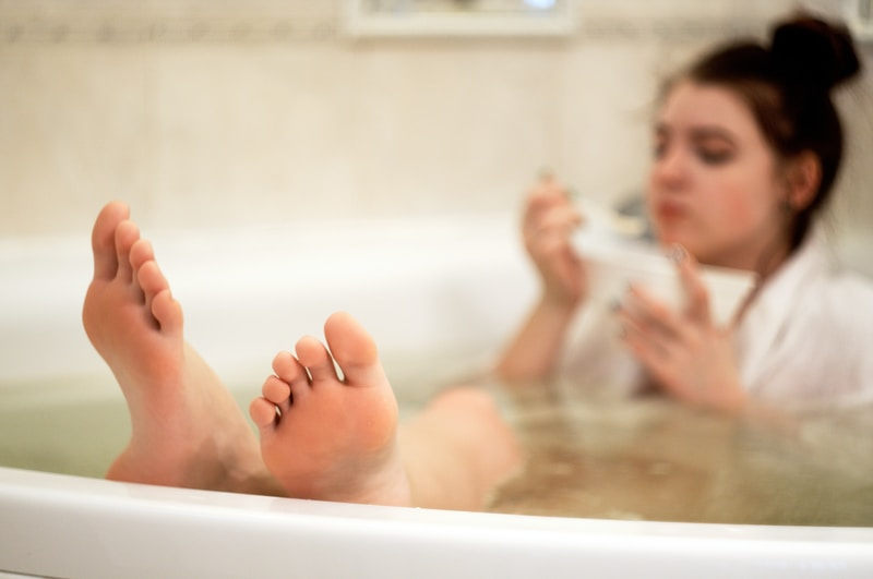 person in bathtub with water