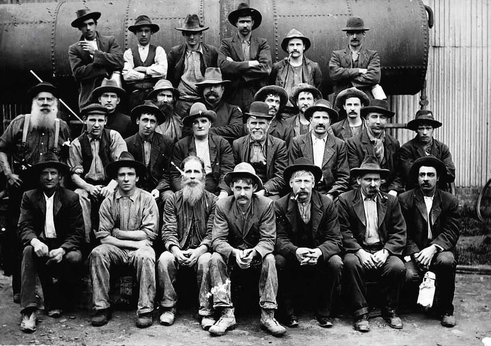 grayscale photo of group of men