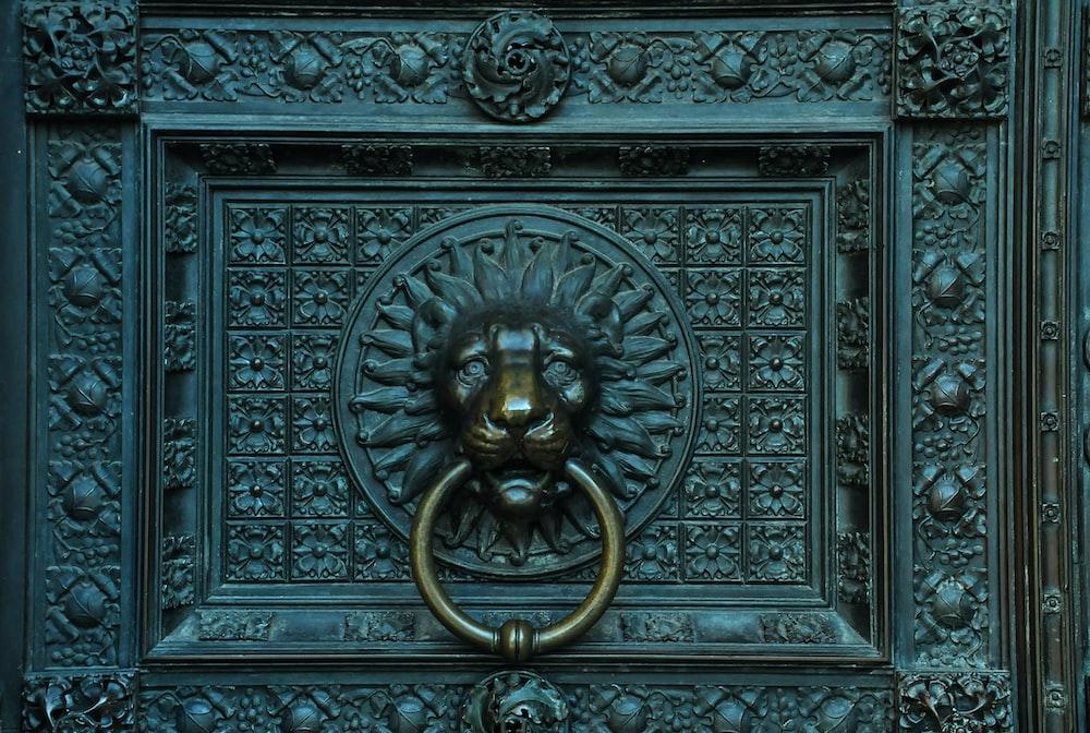 black metal framed gold lion embossed wall decor