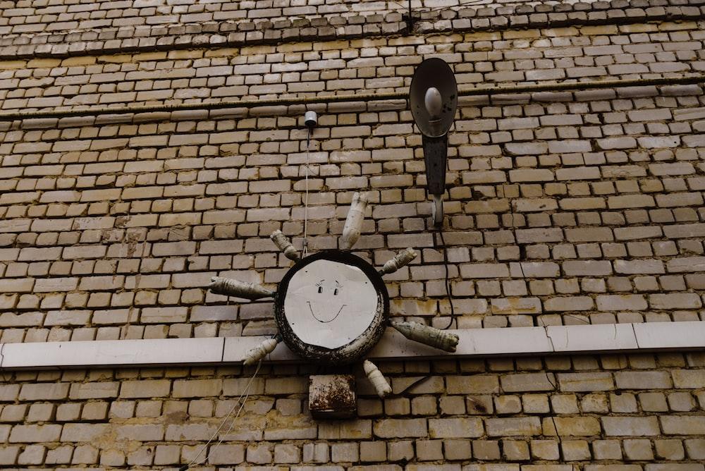 black and white wall mounted round analog clock