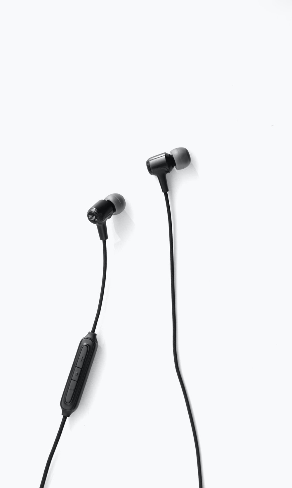 black earbuds on white background