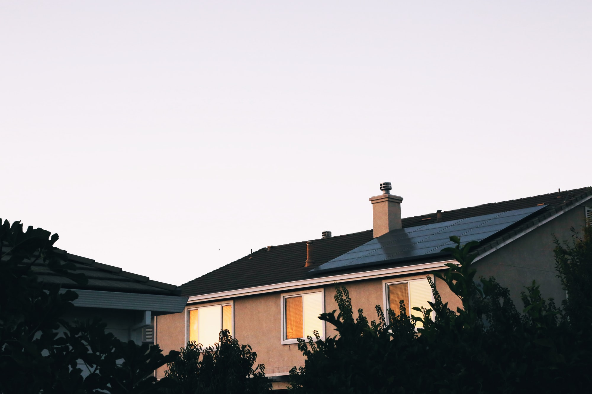 Why rooftop solar and home batteries make a clean grid vastly more affordable