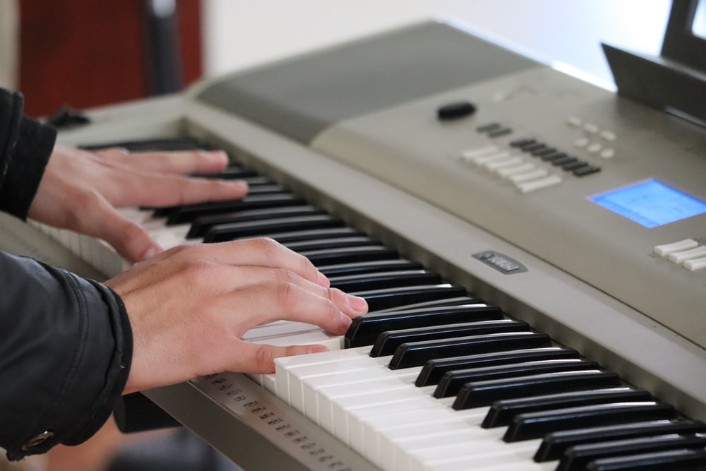 person playing piano inside room