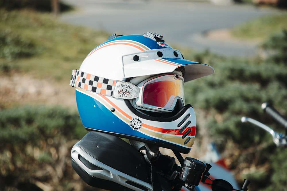 white blue and red motorcycle helmet