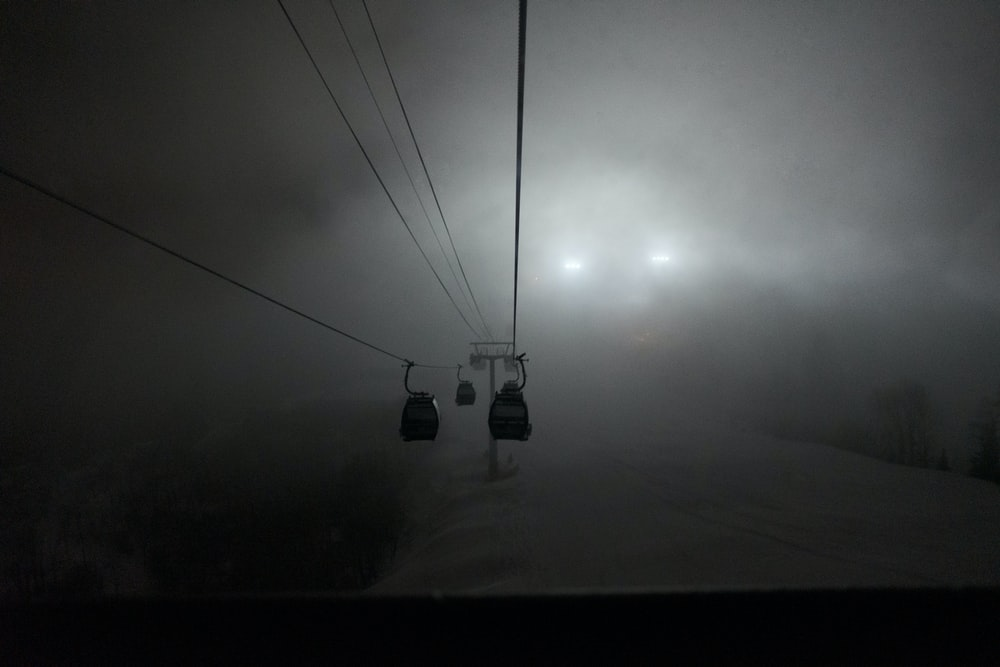 black cable cars on gray sky