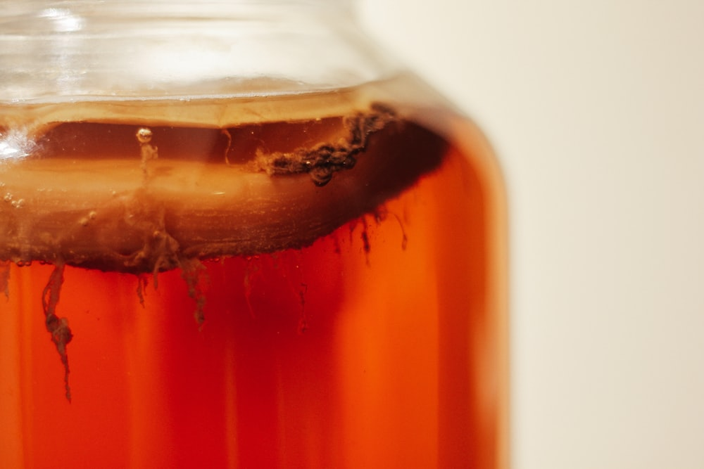 clear glass jar with brown liquid