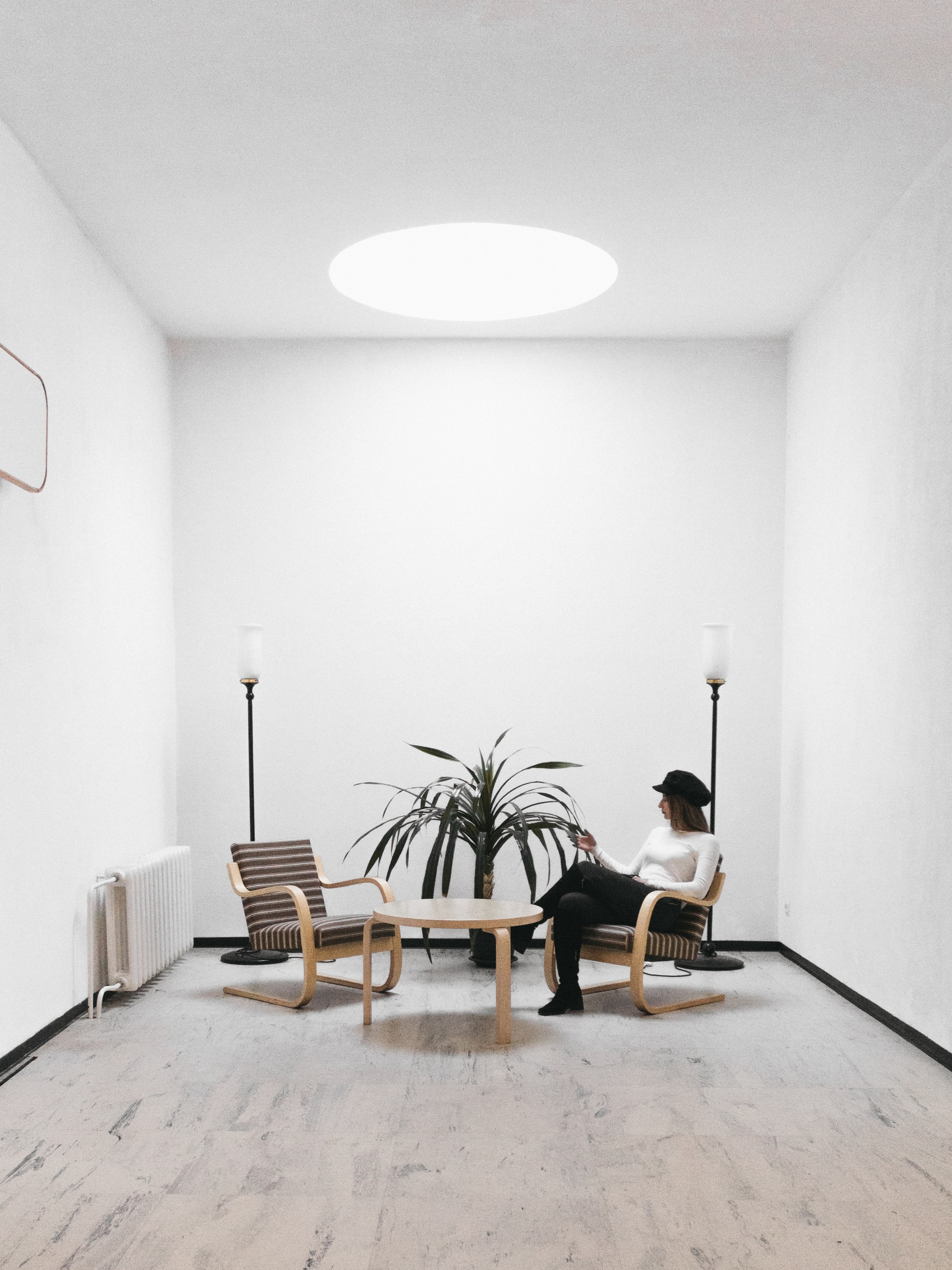 """man in black shirt sitting on brown wooden chair  - photo 1583396796390 6da043f2ba3c ixlib rb 1 - How to use """"Light"""" in your home"""