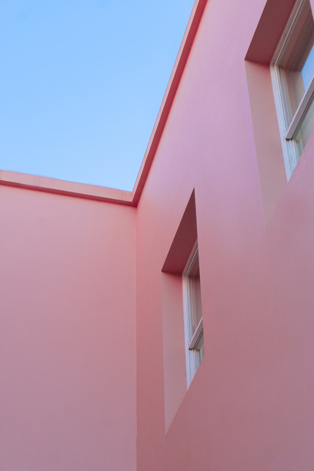 pink concrete building under blue sky during daytime