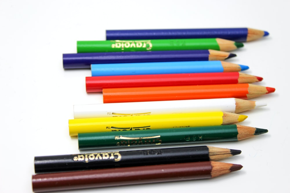 assorted color coloring pencils on white background