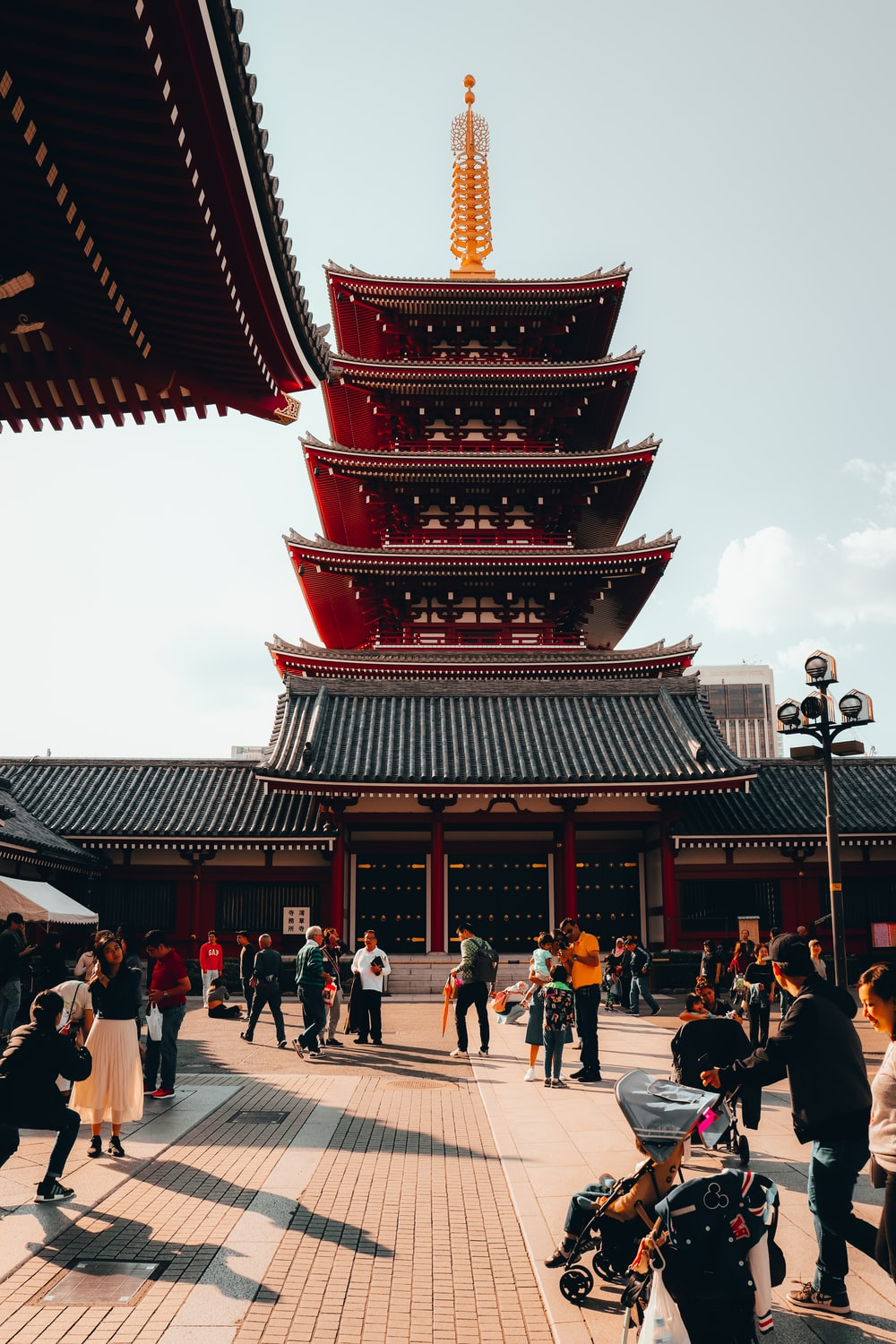 people walking on red and brown temple during daytime