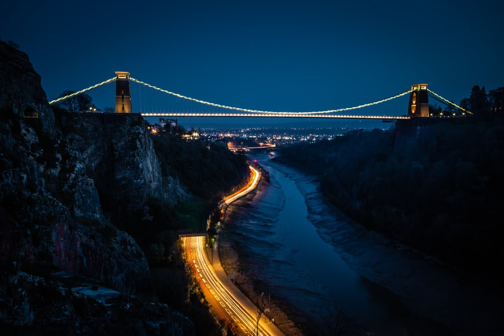 bridge over river during night time