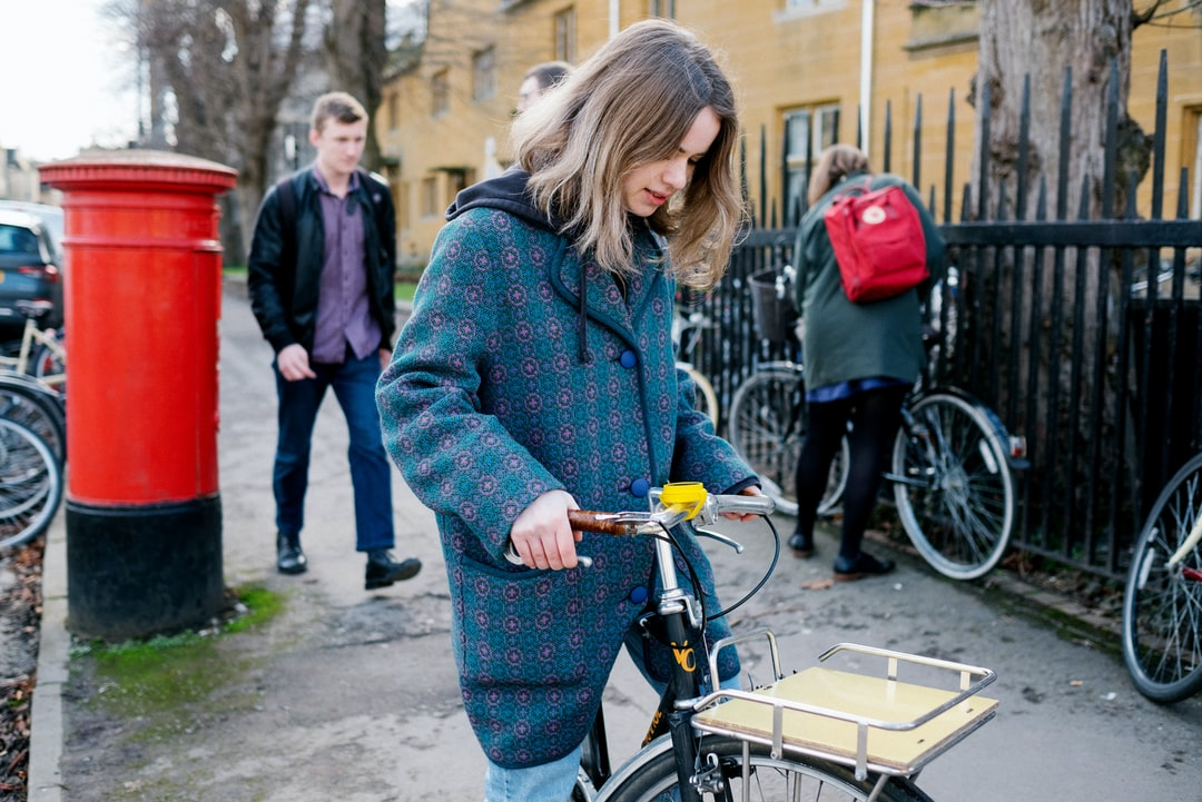 Girl setting off from bicycle parking, following navigation directions