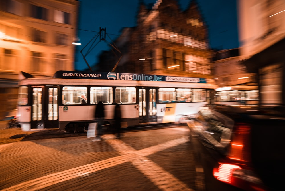 white and black tram on road during night time