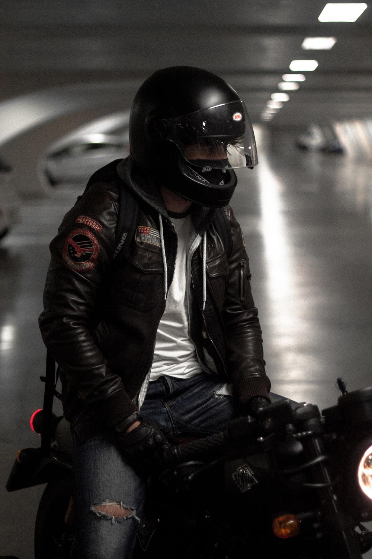 man in black helmet and black jacket