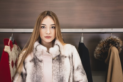 woman in white fur coat fur zoom background