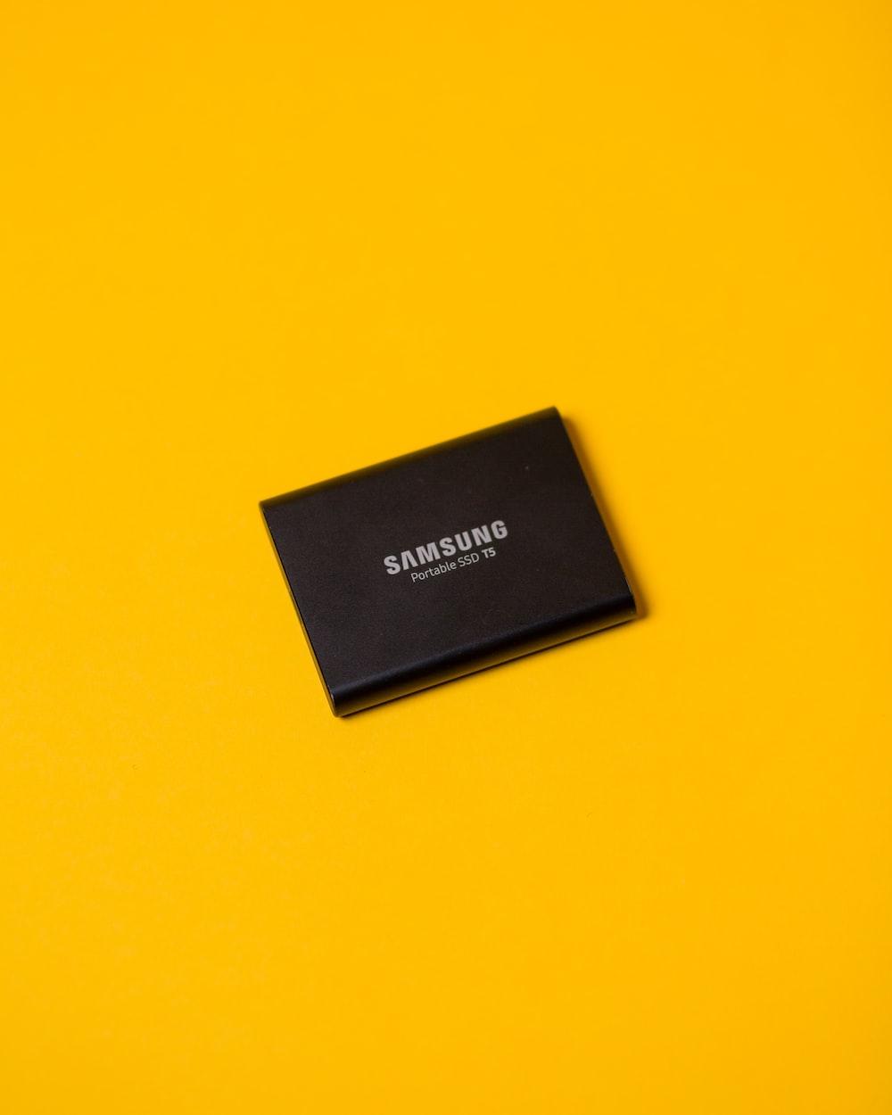 black box on yellow surface