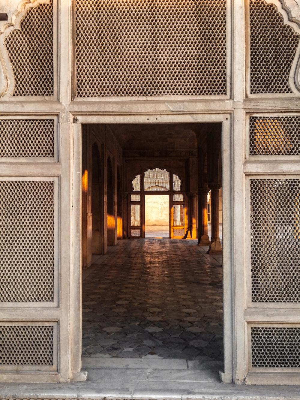 brown brick building with arch door