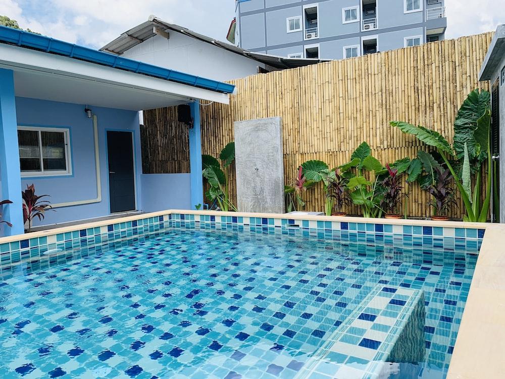 swimming pool near brown brick wall
