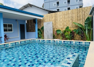 swimming pool near brown brick wall