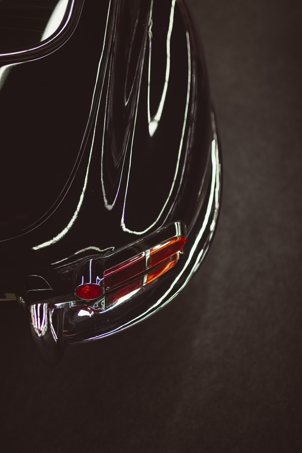 red and black car in close up photography