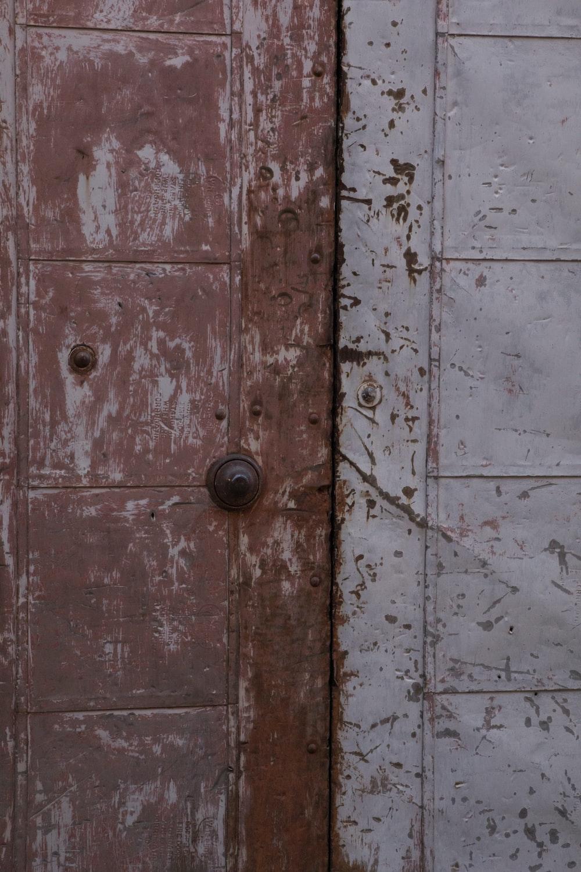 brown wooden door with brass door knob