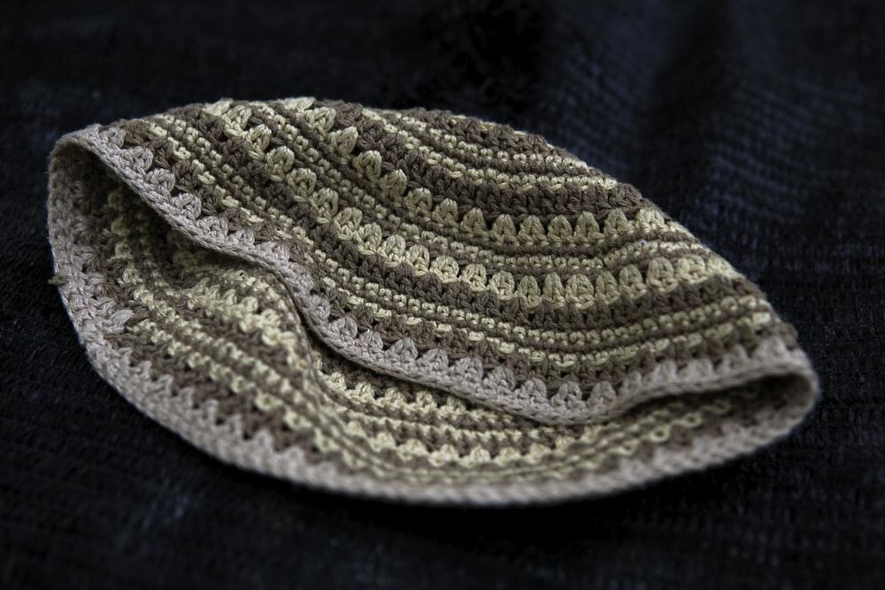 white knit cap on blue textile