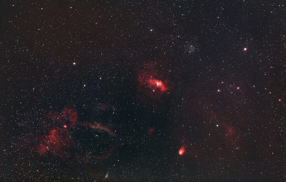 red and black galaxy with stars