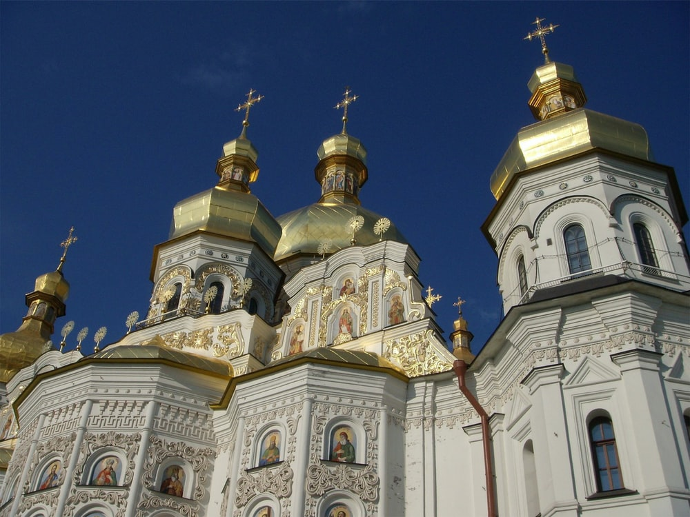 white and gold church under blue sky during daytime