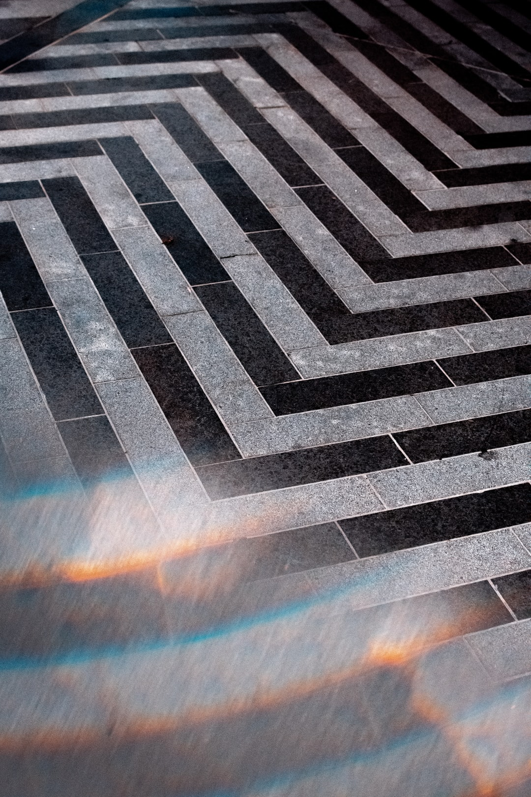 a street floor pattern found in Brisbanes Fortitude Valley with a light refraction reflection