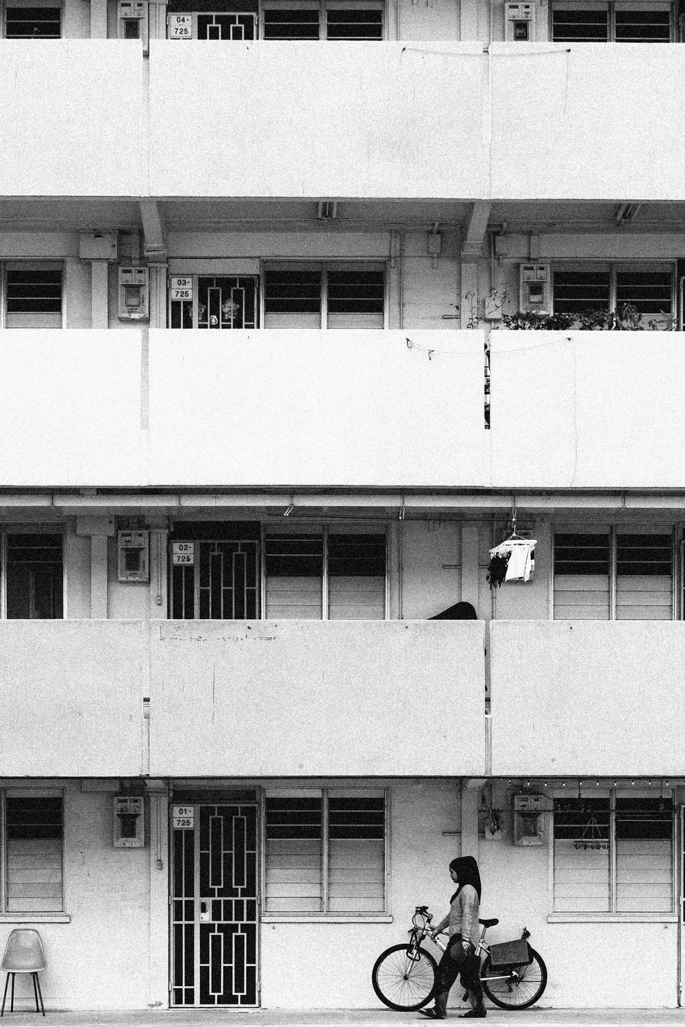 white concrete building with white window blinds