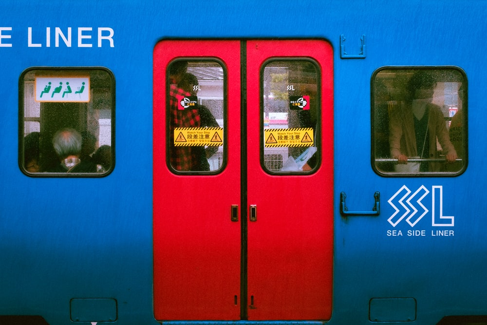 blue and red train door